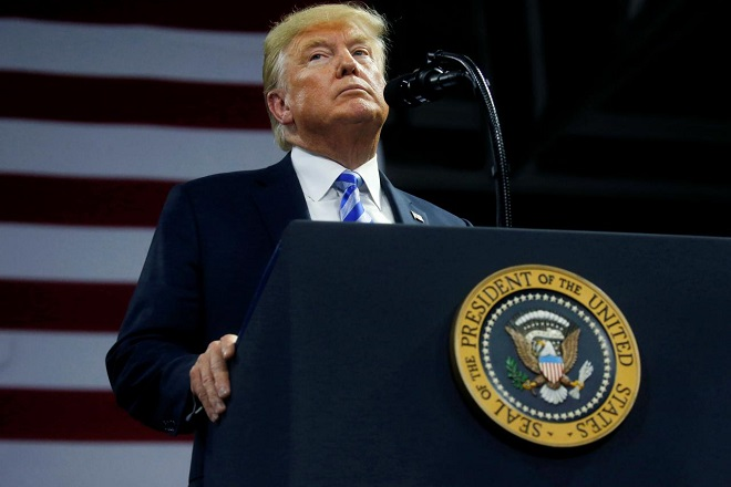 FILE PHOTO: U.S. President Donald Trump speaks at a Make America Great Again rally at the Civic Center in Charleston, West Virginia, U.S., August 21, 2018.  REUTERS/Leah Millis