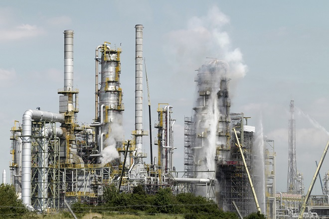 A fire being put off at the petroleum refinery in Leuna, Germany 17 May 2017. Although the cause for the fire in a facility of the refinery is still unclear, it poses no risk to the surroundings. Photo by: Peter Endig/picture-alliance/dpa/AP Images