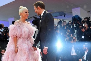 epa06987961 US director and actor Bradley Cooper (R) and US actress, singer and performer Lady Gaga arrive for the premiere of 'A Star Is Born' during the 75th annual Venice International Film Festival, in Venice, Italy, 31 August 2018. The movie is presented Out Competition at the festival running from 29 August to 08 September 2018.  EPA/ETTORE FERRARI