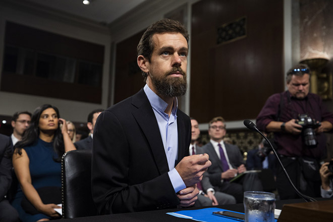 epa06998898 CEO of Twitter Jack Dorsey prepares to testify before a Senate Intelligence Committee hearing on 'foreign influence operations and their use of social media platforms' in the Dirksen Senate Office Building in Washington, DC, USA, 05 September 2018. Lawmakers are expected to ask the top executives what measures they are implementing to protect their online content from Russian propaganda and political censorship. CEO of Alphabet (Google) Larry Page was invited to testify but did not show.  EPA/JIM LO SCALZO