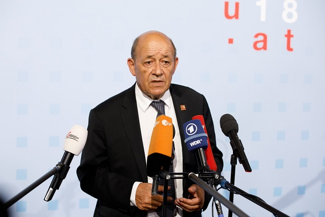 epa06984011 French Foreign Minister Jean-Yves Le Drian talks to the media as he arrives for the informal meeting of European Union foreign affairs ministers at the Hofburg Palace in Vienna, Austria 30 August 2018. Austria hosts a two-day informal meeting of foreign affairs ministers in Vienna on 30 and 31 August. Austria took over its third Presidency of the European Council from July 2018 until December 2018.  EPA/FLORIAN WIESER