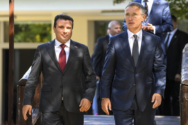 epa07000946 NATO Secretary General Jens Stoltenberg (R) accompanied by Macedonian Prime Minister Zoran Zaev (L) arrives on the press conference in Skopje, The Former Yugoslav Republic of Macedonia, 06 September 2018. NATO Secretary General Jens Stoltenberg is on a two-day official visit to Macedonia.  EPA/GEORGI LICOVSKI