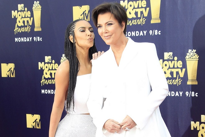 epa06814886 Kim Kardashian (L) and Kris Jenner arrive for the 2018 MTV Movie and TV Awards at the Barker Hanger in Santa Monica, California, USA, 16 June 2018. The movies are nominated by producers and executives from MTV and the winners are chosen online by the general public.  EPA/NINA PROMMER