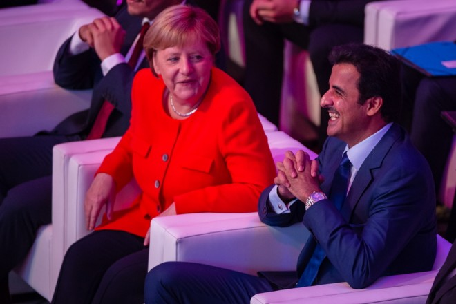 epa07002679 German Chancellor Angela Merkel (L) and the Emir of Qatar, Sheikh Tamim bin Hamad Al Thani (R) share a light moment as they attend the 'Qatar-Germany Forum For Business And Investment' in Berlin, Germany, 07 September 2018. The forum, described as a cross-continental event, according to its organizers gathers high government officials, businessmen and major company representatives from both countries.  EPA/JENS SCHLUETER