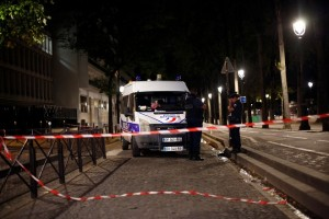 Police officers secure the site of a knife attack in Paris, Monday, Sept. 10, 2018. A several people were injured in a knife attack in central Paris late Sunday but police said that terrorism was not suspected. (AP Photo/Thibault Camus)