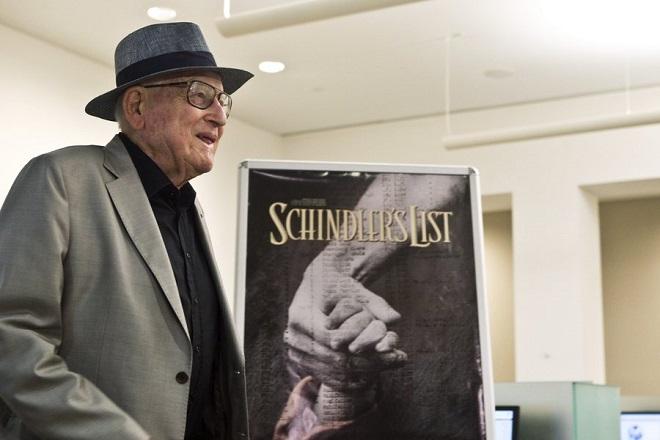 epa04856630 Croatian Auschwitz survivor Branko Lustig stands next to a poster of the 1993 movie 'Schindler's List' at Yad Vashem Holocaust memorial in Jerusalem, Israel, 22 July 2015. Lustig, 83, one of the producers of 'Schindler's List,' presented his Academy Award to Yad Vashem Holocaust memorial, saying it had found its rightful resting place.  EPA/NIR ELIAS / POOL