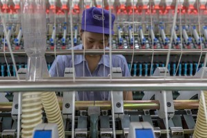 epa07029349 A woman works at a Talak textile factory in Wuxi, Jiangsu Province, China, 16 September 2018 (issued 18 September 2018). The US is imposing new tariffs on 200 billion US dollar of Chinese goods will take effect on 24 September 2018, starting at 10 percent and increasing to 25 percent from the start of 2019, media reported. The biggest round of US tariffs so far will apply to almost 6,000 items and will escalate a trade war with Beijing. The tariffs will include items like handbags, rice and textiles. The Chinese commerce ministry said it will retaliate.  EPA/ALEKSANDAR PLAVEVSKI