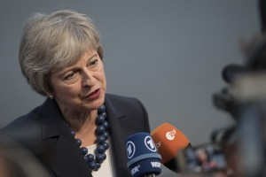 epa07032837 British Prime Minister Theresa May speaks to the media as she arrives for an evening dinner during an Informal Summit of Heads of State or Government in Salzburg, Austria, 19 September 2018. EU countries' leaders meet on 19 and 20 September for a summit to discuss internal security meassures, migration and Brexit.  EPA/ANDREAS SCHAAD