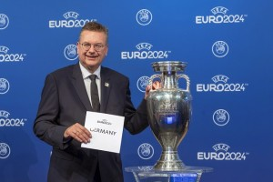 epa07050990 German Football Association (DFB) President Reinhard Grindel poses after the UEFA announced that Germany will host the UEFA EURO 2024 soccer championship during a ceremony at the UEFA headquarters in Nyon, Switzerland, 27 September 2018.  EPA/MARTIAL TREZZINI