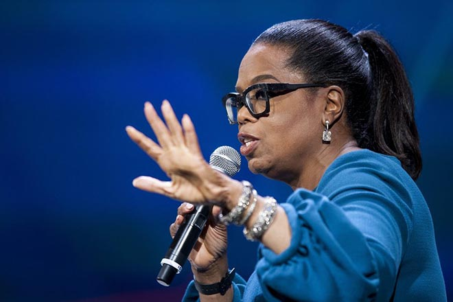 epa05365770 US television personality Oprah Winfrey and US First Lady Michelle Obama (not pictured) speak during the first-ever United State of Women Summit at the Walter E. Washington Convention Center in Washington, DC, USA, 14 June 2016.  EPA/PETE MAROVICH