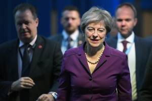 epa07062822 Britain's Prime Minister Theresa May (R) arrives at the conference centre on the third day of the Conservative Party Conference in Birmingham, Britain, 02 October 2018. The Conference runs from 30 September to 03 October 2018.  EPA/NEIL HALL