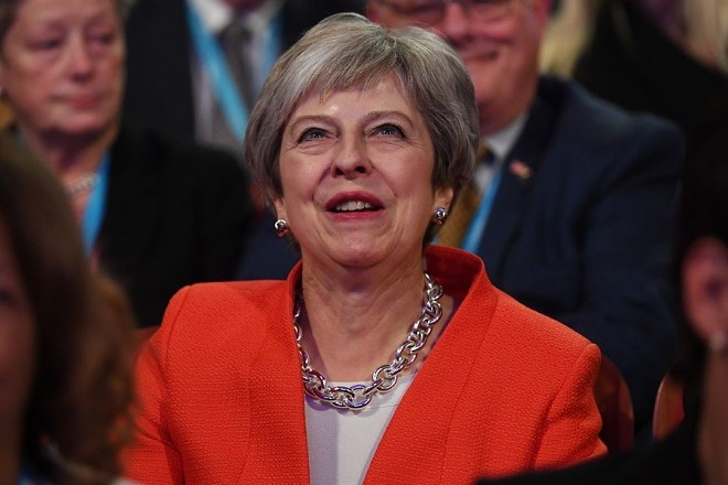 epa07058944 Britain's Prime Minister Theresa May attends the first day of the Conservative Party Conference in Birmingham, Britain, 30 September 2018. The Conference runs 30 September to 03 October 2018.  EPA/NEIL HALL