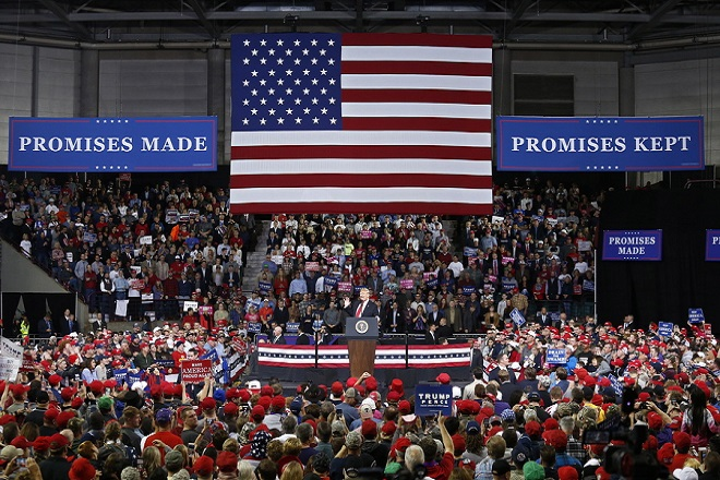 epa07075351 Unites States President Donald J. Trump speaks to supporters at a rally in Topeka, Kansas, USA, 06 October 2018. According to media reports on 06 October 2018, US Supreme Court nominee Brett Kavanaugh was elected to the Supreme Court by the US Senate, that voted in favour 50 to 48.  EPA/LARRY W. SMITH