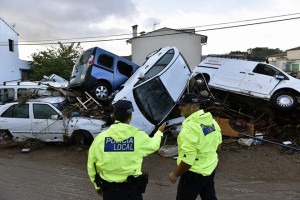 epa07082870 Two local policemen look at vehicles destroyed by the floods in the village of Sant Llorenc des Cardasar, in Mallorca island, eastern Spain, 10 October 2018, a day after the flash floods hit the area. At least six people died and several other people are missing are due to the heavy rains which overflowed the torrent of Sant Llorenc. Some 300 members of emergency services take part in the search operation.  EPA/Atienza