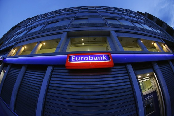 View of a Eurobank branch in central Athens March 11, 2015. Greece's Eurobank reported a jump in fourth-quarter losses on Wednesday as provisions for impaired credit weighed on its bottom line, while the pace of new bad debt formation was steady around third-quarter levels. REUTERS/Yannis Behrakis (GREECE - Tags: POLITICS BUSINESS)