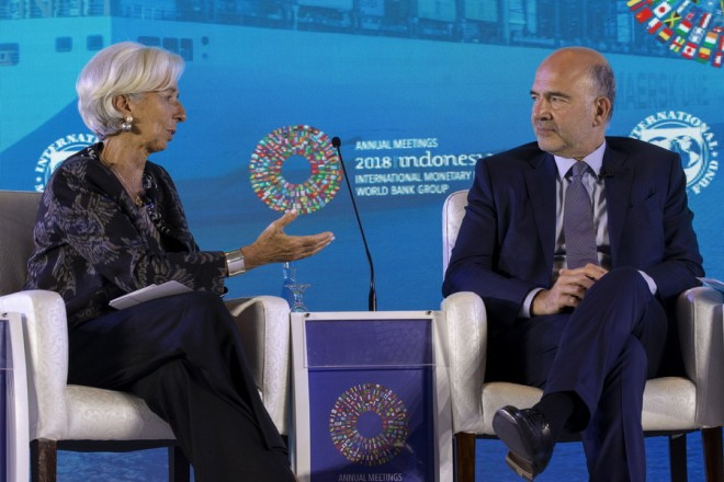 epa07082718 International Monetary Fund (IMF) Managing Director Christine Lagarde (L) talks to European Commissioner for Economic and Financial Affairs Pierre Moscovici (R) during a seminar at the IMF and World Bank annual meeting in Nusadua, Bali, Indonesia, 10 October 2018. Bali is hosting the IMF-World Bank annual meeting from 08 to 14 October 2018.  EPA/MADE NAGI