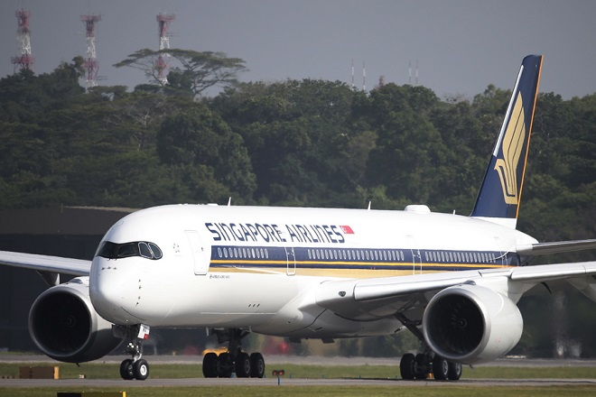 epa07084781 (FILE) - A Singapore Airlines Airbus A350-900 taxies on the runway at Changi Airport in Singapore, 03 March 2016 (reissued 11 October 2018). According to media reports, Singapore Airlines will soon offer a 19-hour long haul flight from Singapore to New York. The air carrier will use Airbus A350-900 planes, offering only business and premium economy seats.  EPA/WALLACE WOON