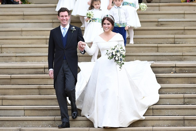 epa07088065 Britain's Princess Eugenie (R) and her husband Jack Brooksbank exit St George's Chapel in Windsor Castle after their royal wedding ceremony, in Windsor, Britain, 12 October 2018.  EPA/NEIL HALL