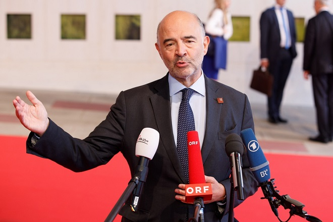 epa07004951 European Commissioner for Economic and Financial Affairs, Pierre Moscovici addresses the media ahead of an Informal Meeting of Economic and Financial Affairs Ministers (ECOFIN) at the Austria Center Vienna (ACV) in Vienna, Austria, 08 September 2018. Austria hosts a two-day Informal Meeting of Economic and Financial Affairs Ministers (ECOFIN) in Vienna on 07 and 08 September. Austria took over its third Presidency of the European Council from July 2018 until December 2018.  EPA/FLORIAN WIESER