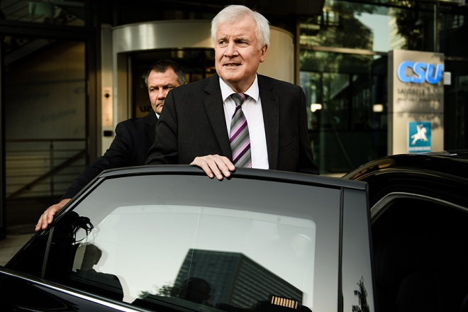 epa07095215 German Minister of Interior, Construction and Homeland and Christian Social Union (CSU) party chairman, Horst Seehofer leaves after a press conference after a CSU board meeting on the day after the Bavaria state elections, in Munich, Germany, 15 October 2018. The CSU lost significant in the 14 October regional elections in Bavaria and gained - according to the provisional official result - a 37,2 percent of the votes but remains the strongest faction in the new Bavarian parliament.  EPA/CLEMENS BILAN