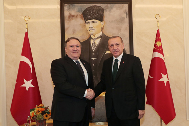 epa07099279 A handout photo made available by the Turkish Presidential Press Office shows US Secretary of State Mike Pompeo (L) shaking hands with Turkish President Recep Tayyip Erdogan (R) during their meeting at Ankara Esenboga Airport in Ankara, Turkey 17 October 2018. Pompeo is in Turkey for a daily visit for talks over missing Saudi journalist Jamal Khashoggi, who disappeared after entering the Saudi consulate in Istanbul, Turkey on 02 October.  EPA/TURKISH PRESIDENTIAL PRESS OFFICE HANDOUT  HANDOUT EDITORIAL USE ONLY/NO SALES