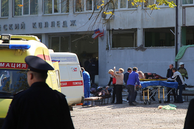 epa07099785 Rescuers work at a vocational school in Kerch in Crimea, 17 October 2018. About 18 people were killed and 40 injured in an suspected explosion and shooting in the school. According to the Russian Investigative Committee, an 18-year-old student has committed suicide after allegedly attacking the school.  EPA/KERCH.FM ATTENTION EDITORS: GRAPHIC CONTENT.