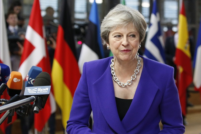 epa07101541 British Prime Minister Theresa May arrives for the European Council summit in Brussels, 18 October 2018. The European Council will focus on migration and internal security and also It will be followed by the Euro Summit in an inclusive format.  EPA/JULIEN WARNAND