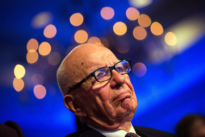 epa03957462 Rupert Murdoch, founder, Chairman and CEO of News Corporation, listens to US President Barack Obama as he responds to questions during the Wall Street Journal CEO Council annual meeting, at the Four Seasons Hotel, in Washington, DC, USA, 19 November 2013. Obama discussed immigration reform and the health care rollout, among other topics.  EPA/DREW ANGERER / POOL