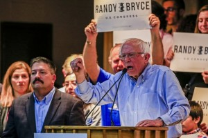 epa07112395 Democratic Congressional candidate Randy Bryce (L) listens as Independent US Senator from Vermont Bernie Sanders speaks on his behalf at a campaign rally at the UAW Local 72 hall in Kenosha, Wisconsin, USA, 22 October 2018. Bryce is running in the 2018 Mid-Term election against Republican Bryan Steil to fill the seat being vacated by US House Speaker Paul Ryan representing the 1st Congressional District in Wisconsin.  EPA/TANNEN MAURY