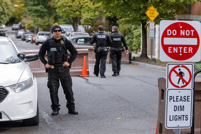 epa07116517 Uniformed US Secret Service officers patrol the street near the private resident of former US President Barack Obama in Washington, DC, USA, 24 October 2018. A suspicious package sent to Obama's home are among several discovered and intercepted in the past 24 hours.  EPA/ERIK S. LESSER