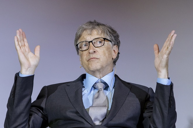 epa07095341 Microsoft founder and co-founder of the Bill and Melinda Gates Foundation Bill Gates gestures as he talks during a conference about the innovations for a healthy future in Africa, at the Technical University (TU) in Berlin, Germany, 15 October 2018. Bill Gates is in Germany for the 'World Health Summit', which started in Berlin on 14 October and ends on 16 October.  EPA/KAMIL ZIHNIOGLU