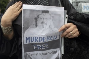epa07113086 Sahar Zeki a friend of Jamal Khashoggi hold picture of Jamal in front of Saudi Arabian consulate in Istanbul, Turkey, 23 October 2018. Turkish President Erdogan addressed the parliament on the case of Saudi journalist Jamaal Khashoggi on 23 October 2018, media reported that he said that Turkish investigators have strong evidence that Khashoggi's death was planned, and demanded that the whereabouts of the dead journalist's body be revealed and the suspects face trial in Turkey. Saudi Arabian official media on 19 October reported that journalists Jamal Khashoggi died as a result of a physical altercation inside the kingdom's consulate in Istanbul, where he was last seen entering on 02 October for routine paperwork.  EPA/SEDAT SUNA