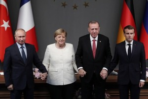 epa07124880 Russian President Vladimir Putin (L), German Chancellor Angela Merkel (2-L), Turkish President Recep Tayyip Erdogan (2-R) and French President Emmanuel Macron (R),  react after their press conference during the Syria summit in Istanbul, Turkey, 27 October 2018. Turkish President Recep Tayyip Erdogan, Russian President Vladimir Putin, German Chancellor Angela Merkel, and French President Emmanuel Macron met in Istanbul to plan a political resolution for the conflict in Syria.  EPA/MAXIM SHIPENKOV / POOL