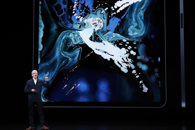 epa07131440 Apple CEO Tim Cook speaks about the new iPad Pro during an Apple special event at the Howard Gilman Opera House at the Brooklyn Academy of Music before the start of an Apple event in New York, New York, USA, 30 October 2018. The event follows soon after a major Apple iPhone product launch in September 2018.  EPA/JUSTIN LANE