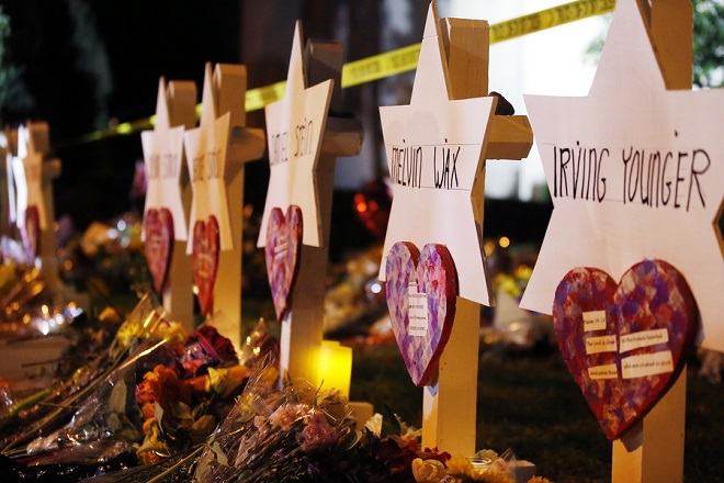 epa07130366 The Star of David memorials are lined with flowers at the Tree of Life synagogue two days after a mass shooting in Pittsburgh, Pennsylvania, USA, 29 October 2018. Officials report 11 people were killed by the gunman identified as Robert Bowers who has been charged with hate crimes and other federal charges .  EPA/JARED WICKERHAM