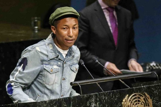 epa04672111 US musician Pharrell Williams speaks as part of an event marking International Day of Happiness at United Nations headquarters in New York, New York, USA 20 March 2015.  EPA/KENA BETANCUR