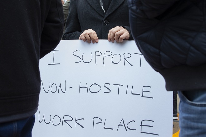 epa07135485 A Google Inc., employee holds a sign that reads 'I Support Non-Hostile Workplace' as employees stage a walkout in their call for a safe workplace in Cambridge, Massachusetts, USA, 01 November 2018. Employees at Google offices worldwide staged the walkouts in a call for an end to sexual harassment, misconduct and a lack of transparency in the workplace.  EPA/CJ GUNTHER