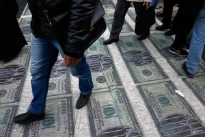 epa07140647 Iranians walk over a banner depicting US dollar banknotes during an anti-US demonstration marking the 39th anniversary of US Embassy takeover, in front of the former US embassy in Tehran, Iran, 04 November 2018. Media reported that Thousands of protesters chanting 'Death to America' gathered at the former US embassy in Tehran to mark the 39th anniversary of the start of the Iran hostage crisis. Iranian students occupied the embassy on 04 November 1979 after the USA granted permission to the late Iranian Shah to be hospitalized in the States. Over 50 US diplomats and guards were held hostage by students for 444 days. US President Donald J. Trump's administration announced on 02 November 2018, that it will reimpose sanctions against Iran that had been waived under the 2015 Iran nuclear deal (the Joint Comprehensive Plan of Action, JCPOA). The US sanctions will take effect on 05 November 2018, covering Iran's shipping, financial and energy sectors. In 2015, five nations, including the United States, worked out a deal with the Middle Eastern country that withdrew the sanctions, one of former US President Barack Obama's biggest diplomatic achievements.  EPA/ABEDIN TAHERKENAREH