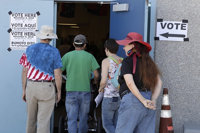 epa07146573 Voters arrive to cast their ballots in the 2018 midterm general election at Jack Dailet Elementary School in Las Vegas, Nevada, USA, 06 November 2018. Voters across the nation are selecting who will represent them on local, state and national levels.  EPA/JOHN GURZINSKI
