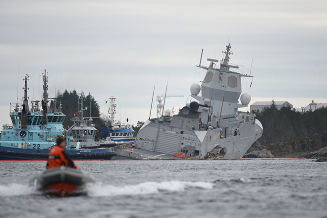 epaselect epa07150332 A view of the Norwegian frigate KNM Helge Ingstad taking on water after a collision with the tanker Sola TS, in a fjord near Oygarden, Norway, 08 November 2018. The frigate, which nearly capsized in the accident, is taking on water and is in danger of sinking, media reported. The cause of the collision, in which seven people were lightly injured, was not immediately clear, media added. The KNM Helge Ingstad was returning back to Haakonsvern naval base, near Bergen, after participating in the NATO-led exercise Trident Juncture 2018 (TRJE18).  EPA/MARIT HOMMEDAL  NORWAY OUT