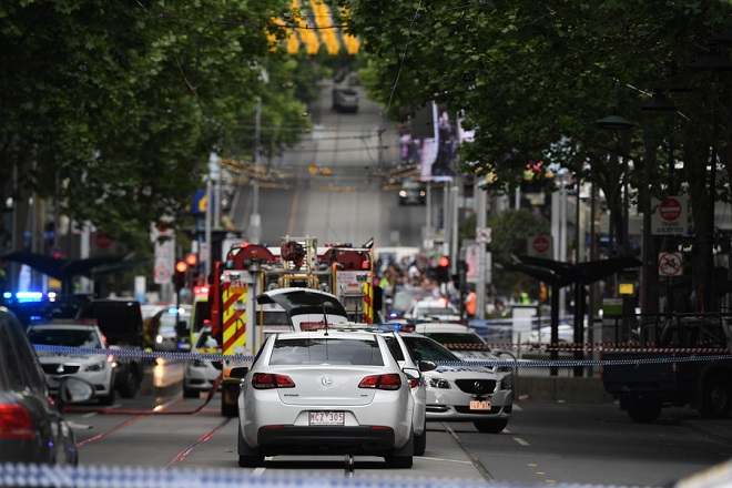 epa07152774 Members of the emergency services attend an incident on Bourke Street in Melbourne, Australia, 09 November 2018. According to early media reports, an unidentified man set a vehicle alight and stabbed two people before being shot by police in the Central Business District of Melbourne. At least one person was killed during the incident. The perpetrator was taken into custody and is reportedly in critical condition.  EPA/JAMES ROSS AUSTRALIA AND NEW ZEALAND OUT