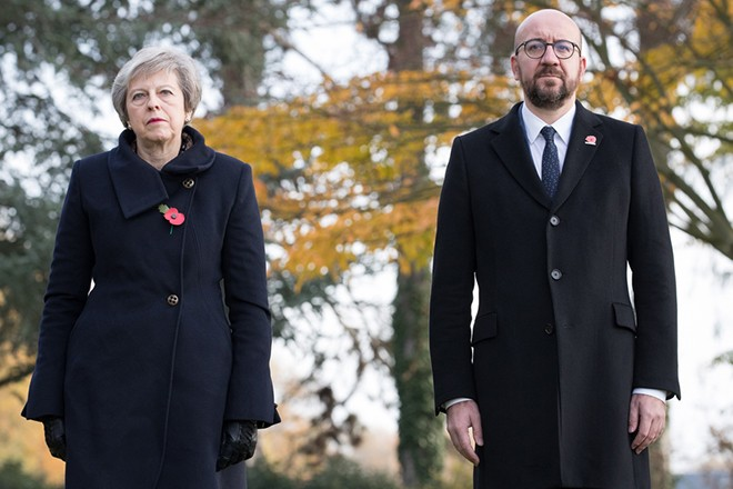 epa07152992 British Prime Minister Theresa May (L) and Belgian Prime Minister Charles Michel (R) during the commemoration of the 100th anniversary of the end of the First World War at the Saint-Symphorien Military Cemetery, in Saint-Symphorien, Mons Belgium 09 November 2018. The cemetery at St. Symphorien was established by the German Army in August 1914 as the final resting place for British and German soldiers who were killed in the Battle of Mons. Among those buried here is Private John Parr of the Middlesex Regiment who was fatally wounded during an encounter with a German patrol two days before the battle, thus becoming the first British soldier to be killed in action on the Western Front. The cemetery remained in German hands until the end of the war and also contains the graves of Commonwealth and German soldiers who were killed in the final days of the conflict, including George Ellison of the Royal Irish Lancers and George Price of the Canadian Infantry. Ellison and Price were killed on Armistice Day 11 November 1918 and are believed to be the last Commonwealth casualties of the First World War. In total, there are 284 German and 230 Commonwealth casualties buried in this site.  EPA/BENOIT DOPPAGNE / POOL