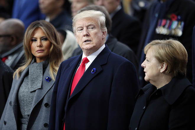 epa07157541 US President Donald J. Trump (C), his wife Melania Trump (L) and German Chancellor Angela Merkel attend the international ceremony for the Centenary of the WWI Armistice of 11 November 1918 at the Arc de Triomphe, in Paris, France, 11 November 2018. Heads of State and Government commemorate their fallen soldiers in France.  EPA/FRANCOIS MORI / POOL MAXPPP OUT