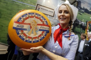 epa05733994 Dutch advertising character 'Frau Antje' (Mrs Antje) poses with a cheese wheel at the stand of The Netherlands during the opening of the International Green Week, in Berlin, Germany, 20 January 2017. The world's biggest fair for agriculture, food and horticulture runs from 20 to 29 January 2017.  EPA/FELIPE TRUEBA