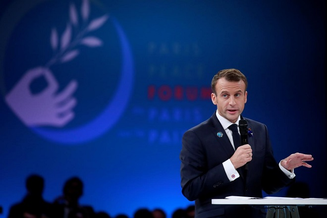 FILE PHOTO: French President Emmanuel Macron delivers a speech at the opening session of the Paris Peace Forum as part of the commemoration ceremony for Armistice Day, 100 years after the end of the First World War, in Paris, France, November 11, 2018. REUTERS/Gonzalo Fuentes/Pool