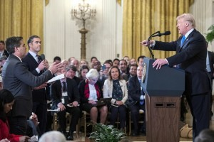 epa07149751 US President Donald J. Trump (R) speaks with CNN reporter Jim Acosta (L) during a press conference in the East Room of the White House in Washington, DC, USA, 07 November 2018. Acosta's White House press access was revoked after the incident.  EPA/ERIK S. LESSER