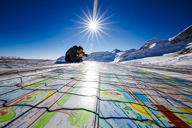 epa07170474 A giant postcard of approximately 2,500 square meters (50x50 meters) and made of contributions from over 125,000 individual postcards containing messages aiming to fight climate change and global warming, is pictured on the Aletsch glacier near the Jungfraujoch saddle (3,446 meters) by the Jungfrau peak (4,158 meters), Switzerland, 16 November 2018. Each individual postcard includes climate change promises and messages from children and youth originating from 35 countries worldwide and aims to establish the Guinness world record of the largest composed postcard with the most overall contributors. The 1.5 degrees Celcius written in the center of the postcard refers to a target of limiting global warming to 1.5 degrees Celsius.  EPA/VALENTIN FLAURAUD