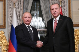 epa07177493 Russian President Vladimir Putin (L) shakes hands with Turkish President Recep Tayyip Erdogan (R) during a meeting in Istanbul, Turkey, 19 November 2018. The two leaders met to discuss Russian-Turkish relations and topical regional and international issues.  EPA/RAMIL SITDIKOV/ KREMLIN POOL/SPUTNIK / POOL MANDATORY CREDIT