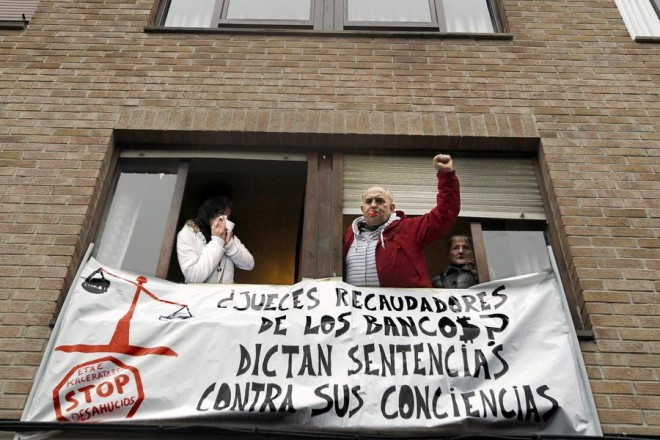 epa03487317 Maria Pilar Martinez Ramos (L) and members of Mortgage Victims' Platform (PAH), celebrate after learning her eviction was stopped in Navarra, northern Spain, 26 November 2012. Spain's crisis has brought a large number of evictions due to unpaid mortgage loans  EPA/IVAN AGUINAGA