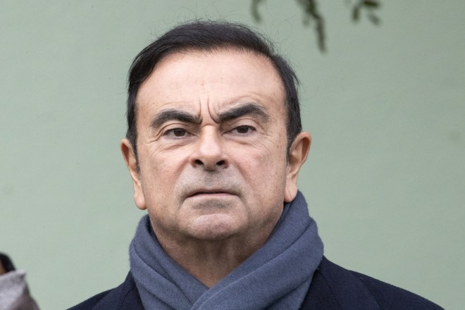 epa07176725 (FILE) - Nisan Chairman Carlos Ghosn waits for French President Emmanuel Macron (not pictured) for a visit of the Renault factory in Maubeuge, northeastern France, 08 November 2018, reissued 19 November 2018). Media reports on 19 November 2018 state that Nissan is dismissing chairman Carlos Ghosn from his post over financial misconduct claims after conducting an internal investigation which showed Mr Ghosn had been allegedly under-reporting his pay.  EPA/ETIENNE LAURENT *** Local Caption *** 54759425